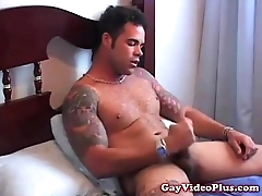 Tattooed stud plays with his cock