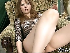 Oriental bitch gets down with dildo