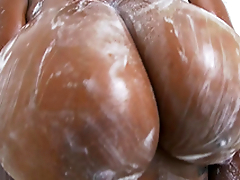 Rachel Raxxx gets her prominent tits all soapy and wet