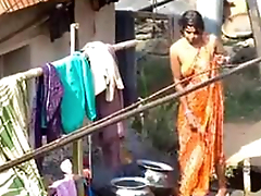 village bhabhi bathing alfresco