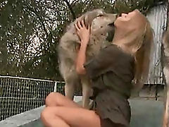 Horny and horny mistress kisses a dog on the porch of the lodging