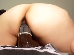 sexy mature ridding on black huge dildo
