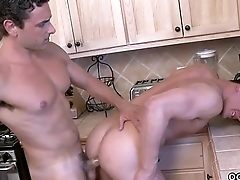 Muscular men fuck in the kitchen